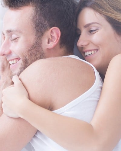 bigstock-couple-embracing-in-bed-126632879.jpg__400x500_q90_crop_subsampling-2