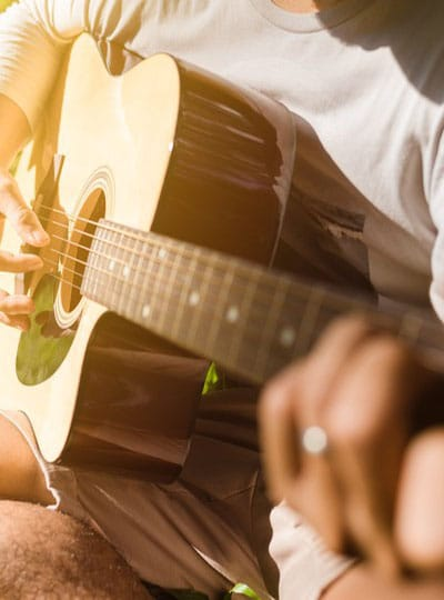 bigstock-man-fingers-playing-guitar-out-238388701.jpg__400x500_q90_crop_subsampling-2